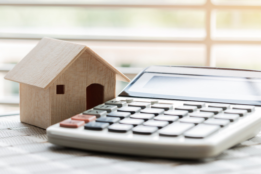 https://larkinmobilenotaryservices.com/wp-content/uploads/2021/06/wooden-house-model-calculator-budget-payment-buying-home-ideas-property-real-estate.jpg